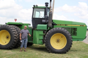 Director of Agriculture Amos Hinton with his 190 horse power John Deere