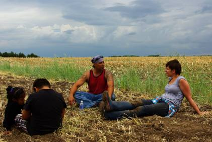 Bold Nebraska's Jane Kleeb and Ponca activist Mekasi Camp-Hornek rest while planting corn. Photo by Mark Hefflinger from Bold Nebraska