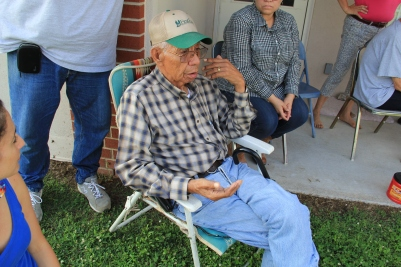 Muscogee elder Sam Proctor, holding corn seed and reminiscing about the types of corn that his mom used to grow and cook