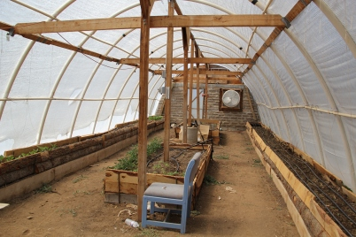 Greenhouse utilized by Not Forgotten Outreach, a veterans program. The raised beds are waist high in order to be accesible by wheel chair. Photo by Angelo Baca
