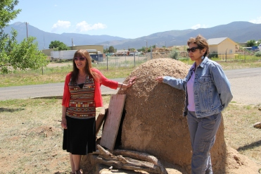 Pati and Terri with New Mexico's only FDA approved horno (traditional adobe oven), at the Taos Food Center