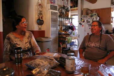 Margaret and Clayton in their kitchen with some of their traditional corn. Photo by Angelo Baca