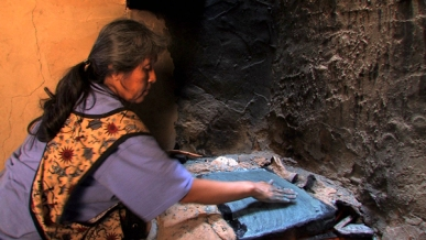 Ruby Chimerica (Hopi) making piki bread. Photo courtesy of KCET