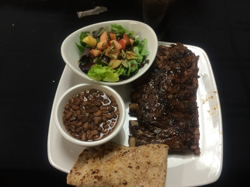 Delicious food from TOCAs Desert Rain Cafe. Prickly Pear glazed ribs, tepary beans, and salad with prickly pear dressing