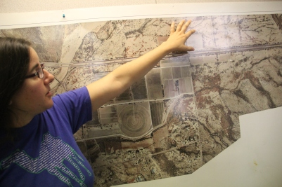 Cie'na Schlaefli, the farm's Propagation Manager, with a map of the farm. Photo by Angelo Baca