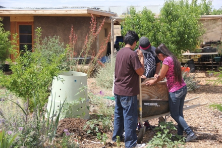 Interns Kylan Yazzie, Ashley Kyasyousie adn Juhriene Alaine Poleahla sift compost. Photo by Angelo Baca