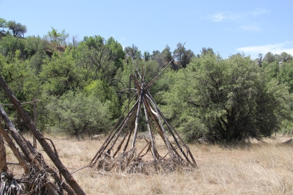 Replica widkiups, traditional Apache houses, built by the Nohwike' Bágowa (House of our Footsteps) tribal museum and cultural center. Photo by Angelo Baca