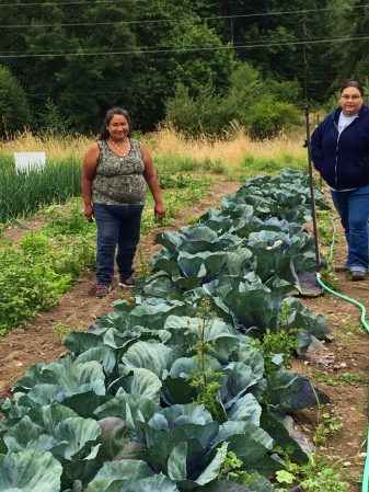 Grace Ann and volunteer Jenny in the cabbages. Photo by Elizabeth Hoover