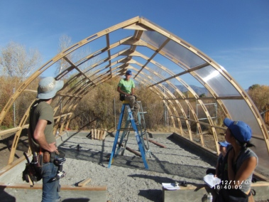 Building the greenhouse frame. Photo by Keith Glidewell
