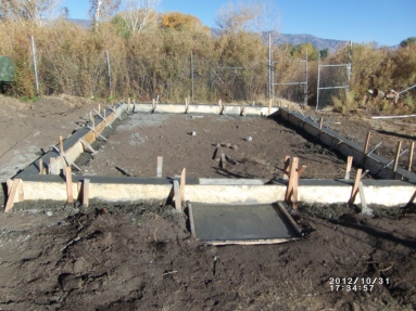 Pouring the foundation for the greenhouse. Photo by Keith Glidewell