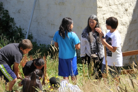 Judy with NAYA youth in the demonstration garden. Photo by Angelo Baca