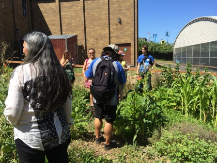 Judy with students in the demonstration garden. Photo by Elizabeth Hoover