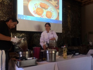 Lois Ellen Frank (Kiowa) and Walter Whitewater (Navajo) giving a demonstration on Native food (in this case making cakes from sunflower seed meal topped with blended fruit) at the Celebration of Basketry and Native Foods festival, Tucson AZ December 2013. Photo by Elizabeth Hoover