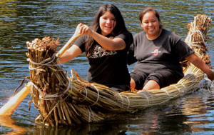 Participants from the Federated Indians of Graton Rancheria have  a blast riding on the Tule boat built at the community workshop. Photo courtesy of TCC