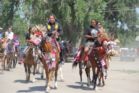 Parade for the Oglala Wacipi, July 2014. Horses are still an important part of life and culture on Pine Ridge. Photo by Angelo Baca