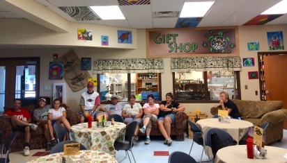 People lounging in the Keya Cafe in front of the gift shop, waiting for their lunch. Photo by Elizabeth Hoover