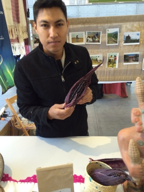 Delegate from Mexico holding up the dark purple corn they use to make flour. Photo by Elizabeth Hoover