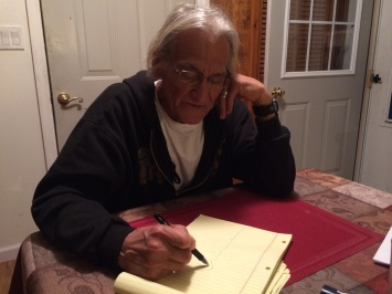 Tom Cook, drawing a map of uranium mining in southwestern South Dakota. Photo by Elizabeth Hoover