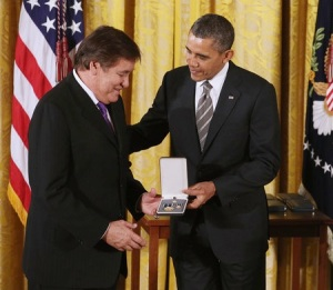 Billy Mills receiving the Presidential Citizen Medal in 2012 for his work with Running Strong.