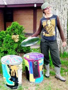 Christina with artistic trash cans, spring 2013. Photo courtesy of the Women's Environmental Institute