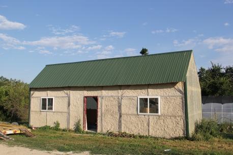 SBAP hemp house, built using timber framing and bricks made of
