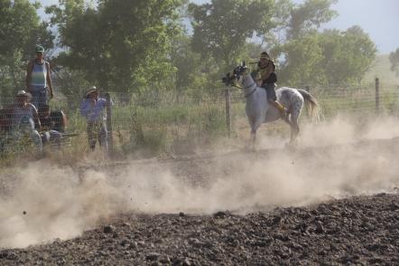 Horse race at Pine Ridge. Photo courtesy of Angelo Baca