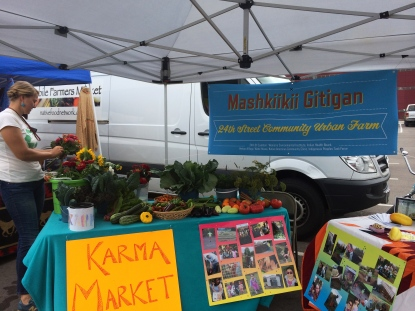Annelie Lindgerg-Livingston, the administrative coordinator for the Mashkiikii Gitigan garden, at the Karma Market set up as past of the Open Streets festival on Franklin Ave. Photo by Elizabeth Hoover