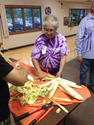 Braiding corn at one of the Elders Sharing Circle events. Photo courtesy of Food Is Our Medicine