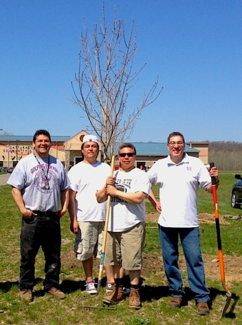Planting sugar maples at the community center. Photo courtesy of Ken Parker