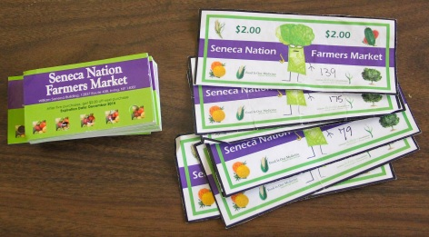 Coupons given to kids to buy fruits and vegetables at the farmers market. Photo by Elizabeth Hoover