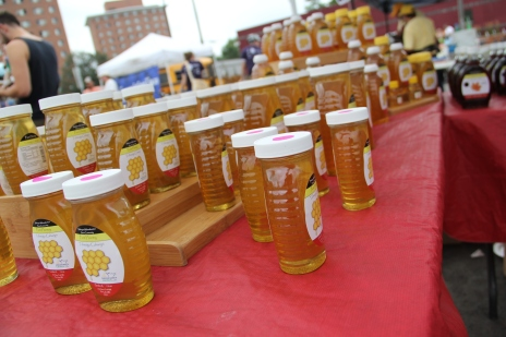 Wozupi honey jars at the farmers market. Photo by Angelo Baca