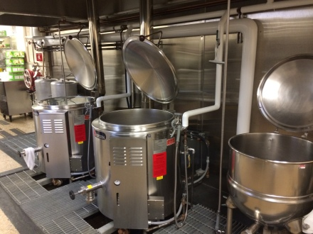 The smaller kettle to the right is run by steam, powered by the boiler (which was not working in August). Luckily the cannery also owns gas powered kettles in which they have continued to process the white corn. Photo by Elizabeth Hoover (August 2014)