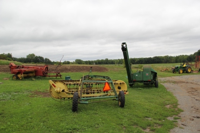 Some of the vintage farm equipment that Tsyunhehkw^ staff have revitalized to work the corn fields. Photo by Angelo Baca