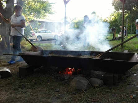 Parching wild rice over a fire. Photo courtesy of Dan Cornelius