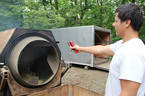 Taking the temperature of the roasters. That chaff you see coming out the front clings to everything at the site-- I left completely covered. It's an itchy job! Photo by Elizabeth Hoover 8/30/14