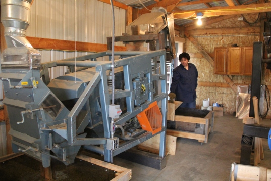 The de-hulled rice is then sent to another machine to have the remaining chaff removed. Photo by Elizabeth Hoover