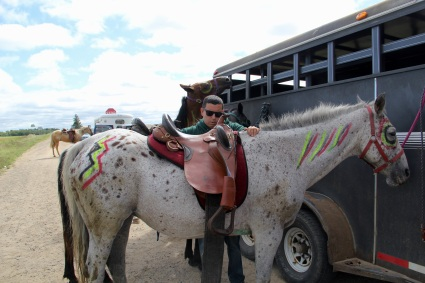 Charlie Thayer (Ojibway) saddling his horse. Photo by Elizabeth Hoover