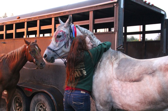 Molly giving Phantom a hug after a long ride. Photo by Elizabeth Hoover