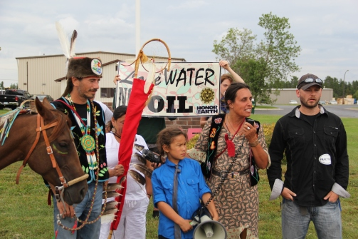 Michael Dahl, Winona LaDuke and Shane Davis at the Honor the Earth press conference outside of Enbridge's Bemidji office. Photo by Elizabeth Hoover