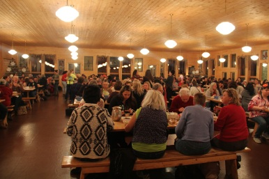 This year's conference crowd filled the entire Maplelag dining room, where people gathered for three home cooked meals a day, and to talk and visit. Photo by Elizabeth Hoover