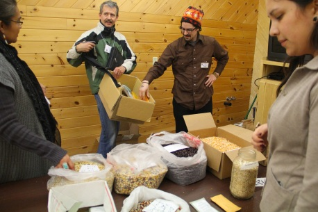 Frank Kutka (in the green coat) is the North Dakota SARE Coordinator and the Dickinson Research Extension Center Assistant Director. He is also a corn breeder who has been working for years to develop organic corn varieties suitable to the northern plains. Frank has worked with a number of Native communities to help preserve and develop their corn, and has given away a great deal of corn to indigenous farmers in the upper midwest. To his left (in the red hat) is Zachary Paige (farm manager for WELRP), who worked to coordinate this conference. Photo by Elizabeth Hoover