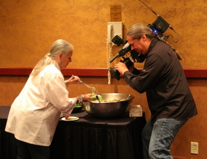 Loretta plating her salad while Boots Kennedeye films. Boots is working with Visionmaker Media on the  next installment of the Growing Native documentary series. Photo by Elizabeth Hoover