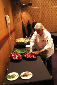 "Loretta plating a ""Three Sisters and Friends"" salad. Photo by Elizabeth Hoover"