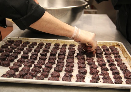 Sean making little cakes out of shredded buffalo meat and berries. Photo by Elizabeth Hoover