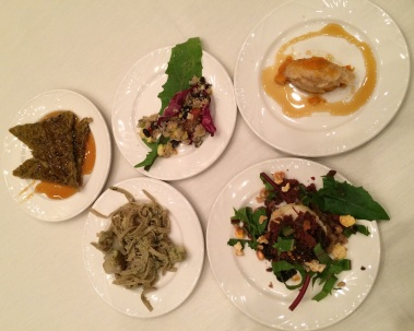 All of the individual small plates: On the far left, wild rice and squash cakes made by Dan Cornelius, with maple syrup by Spirit Lake Native farms. Next, wild rice noodles from Shane Plumer's Red Thunderbird Endeavor, with a dandelion, garlic, sunflower seed pesto, and sunchokes by Sean Sherman. Then a tasty little corn cake with dandelion greens, beans (with cedar and sage), dried buffalo meat, wojapi, and a toasted corn and seed mix, also by Sean. Upper middle plate is a three sisters salad by Loretta Barrett Oden with quinoa, corn, beans, squash, jicama, tomatoes, bell peppers with a rice wine vinaigrette. And the upper right dish is a tasty corn mush and with squash and a drizzle of maple syrup by  Arlie Doxtator. Photo by Elizabeth Hoover