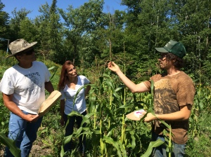 Zach Paige teaching a seed saving workshop on the WELRP farm. Photo by Elizabeth Hoover
