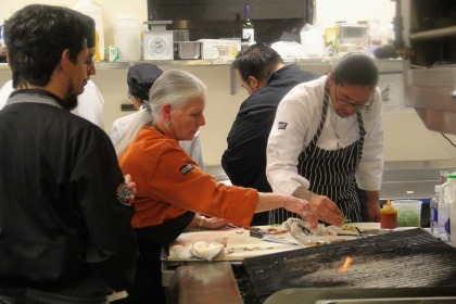 Chefs Loretta Barrett Oden and Karlos Baca arranging the duck plate. photo by Elizabeth Hoover