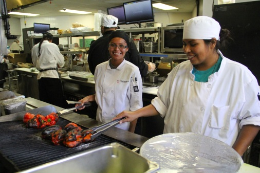Navajo tech students roasting peppers. Photo by Elizabeth Hoover