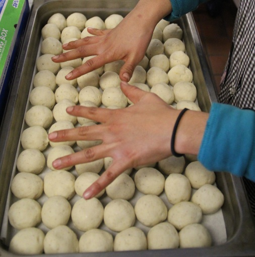 balls of yucca flour, and Marlene's hands. Photo by Elizabeth Hoover