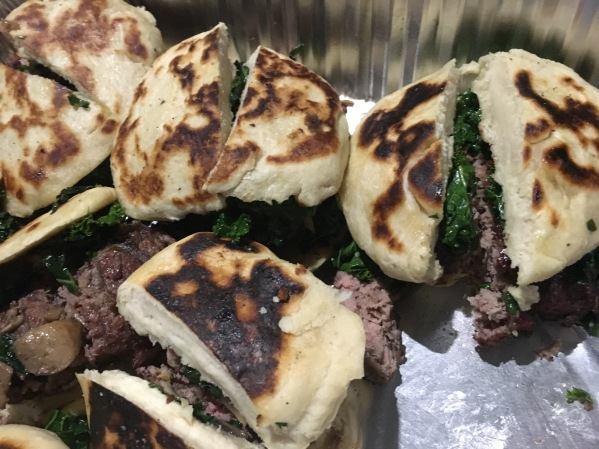 The hands-down best burger I've ever had-- smoked buffalo burgers with mushrooms and kale, and hand made buns. Hasty photo by Elizabeth Hoover (before stuffing them into my mouth)